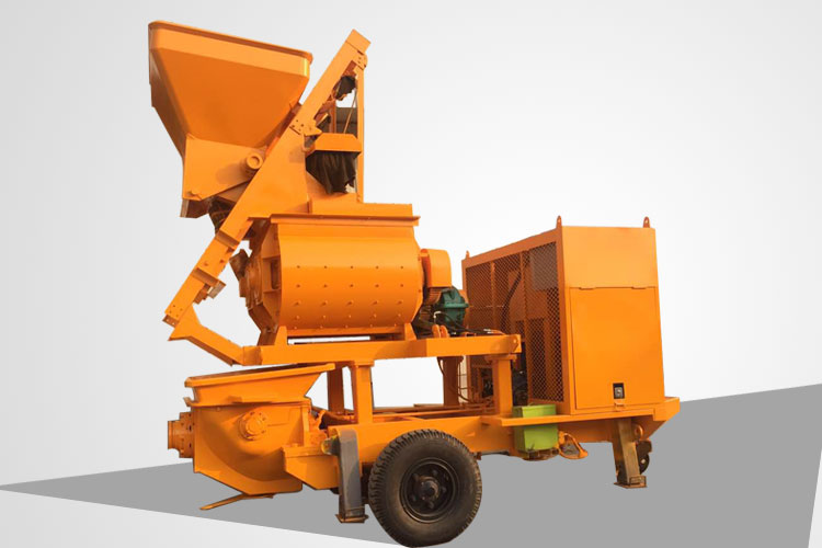 Towable concrete mixer with pump